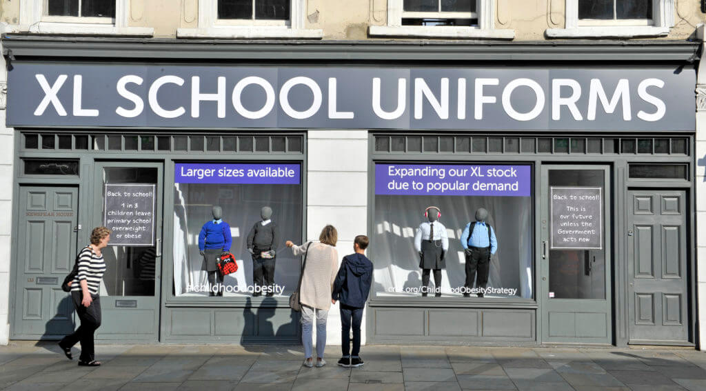 Cancer Research UK created a school uniform shop highlighting how XL uniforms could become the norm if the Government doesnÕt take stronger action to tackle childrenÕs obesity following the release of their Childhood Obesity Plan. Email your MP to act now at cruk.org/ChildhoodObesityStrategy . This photo may only be used in for editorial reporting purposes for the contemporaneous illustration of events, things or the people in the image or facts mentioned in the caption. Re-use of the picture may require further permission from the copyright holder. Photo credit should read: Adrian Brooks/Imagewise