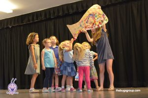 young girls performing in a stage show at dance bugs holiday camp