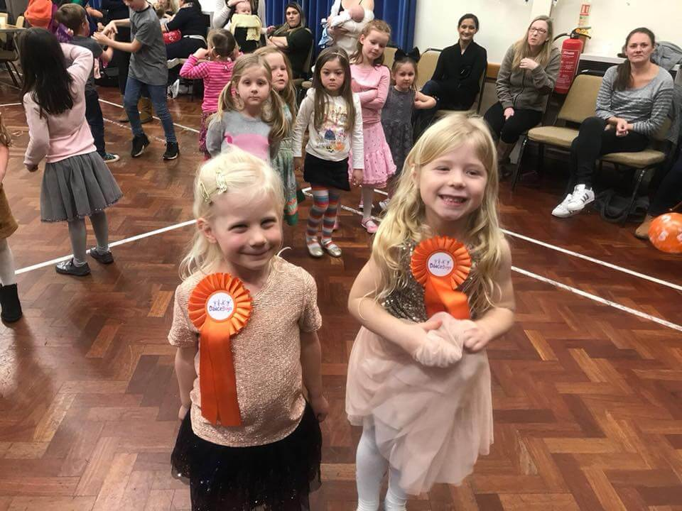 children in a hall celebrating a dancebugs birthday party