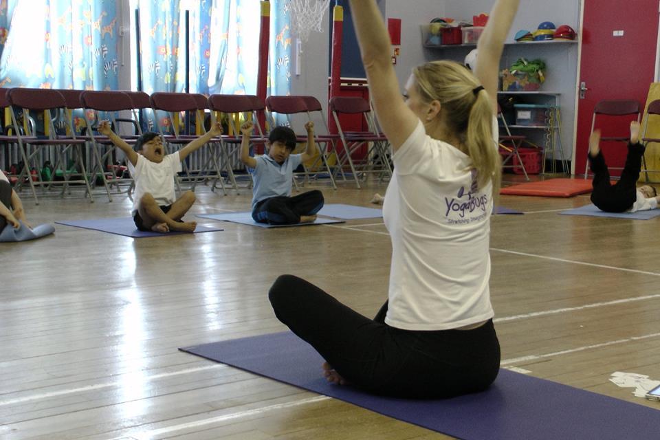 a yogabugs teacher leading a class of children