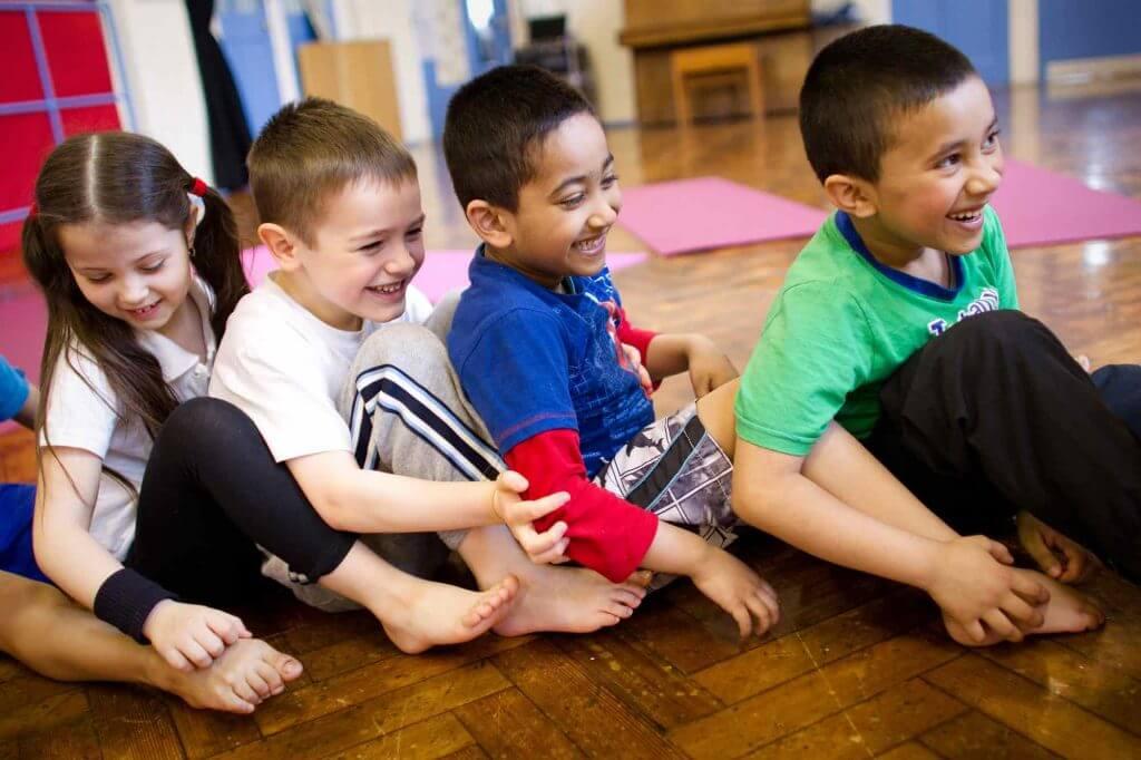 children having fun at a yogabugs session