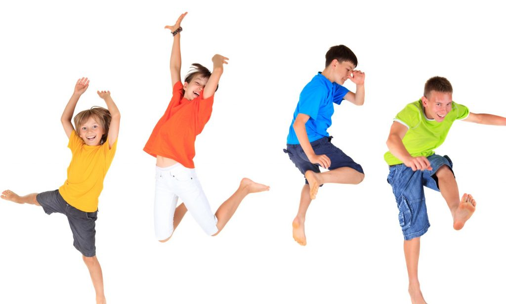 kids jumping in the air in brightly coloured clothes