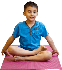 a young boy sat cross legged in a yoga pose