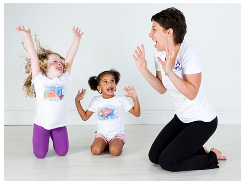 a yogabugs coach and two children enjoying a session