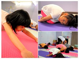 a montage of images of children performing yoga