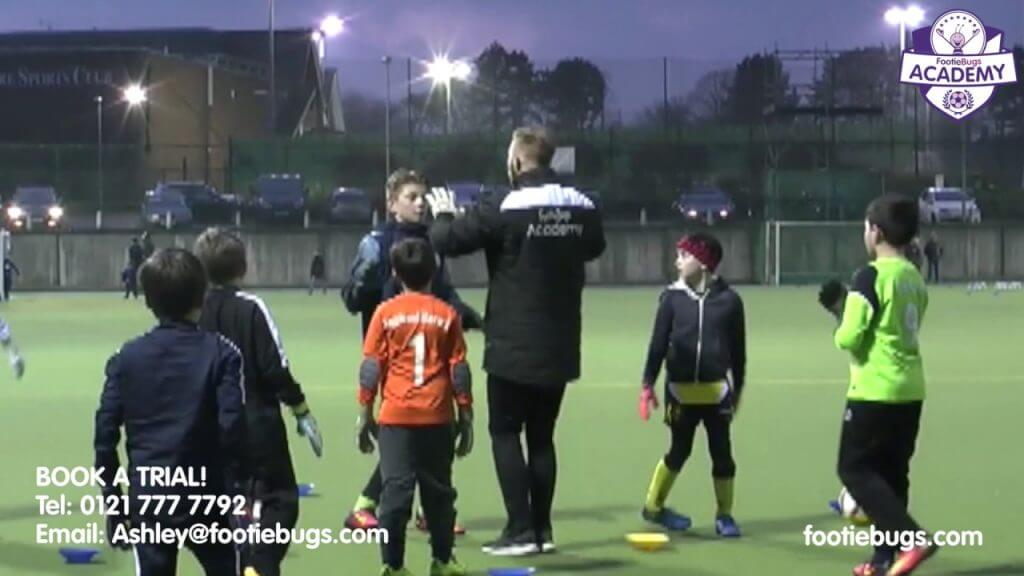a footiebugs session on an outdoor pitch at night
