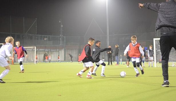 kids kicking a football