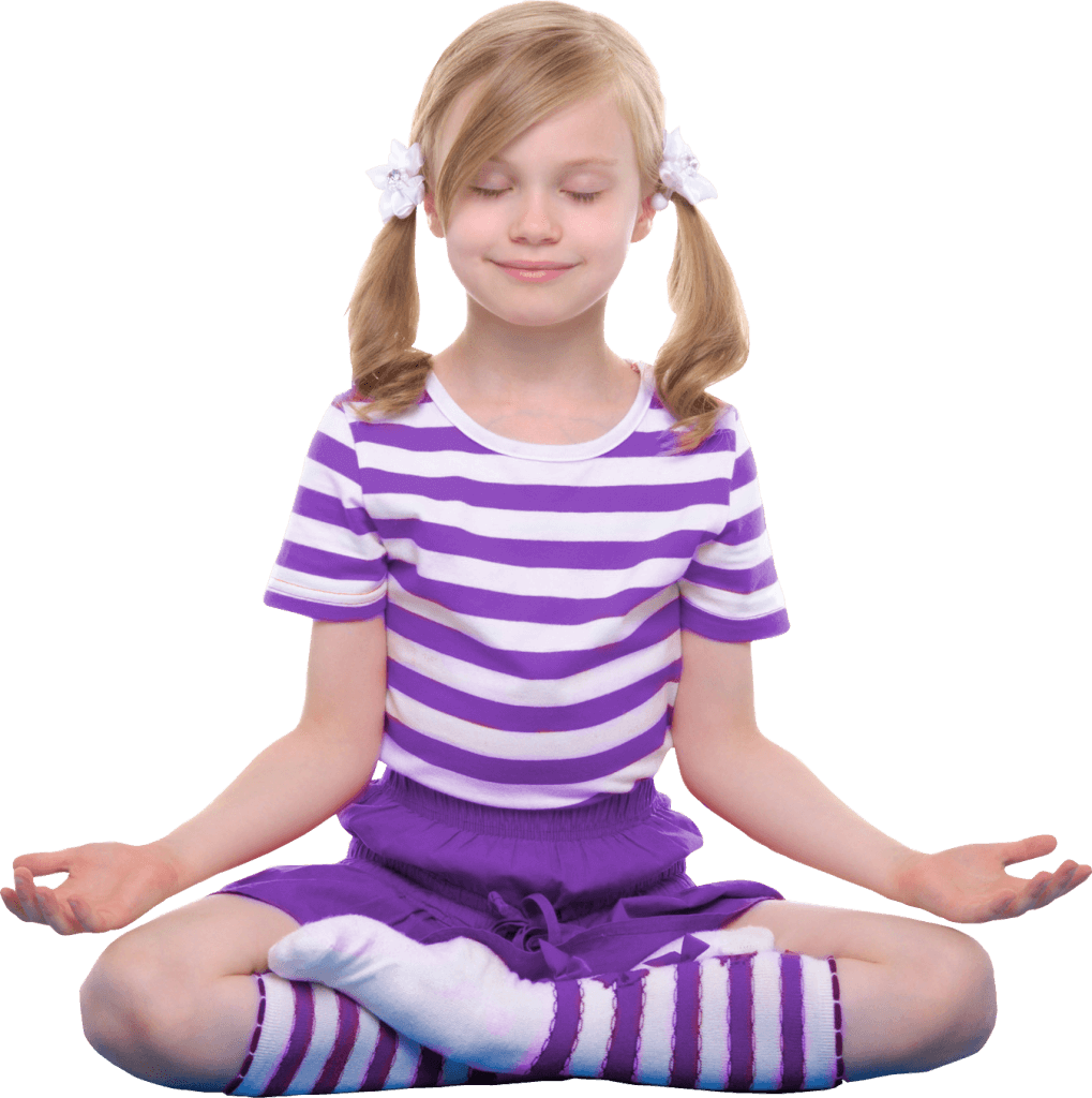 young girl sat crossed legged in a yoga pose smiling calmly