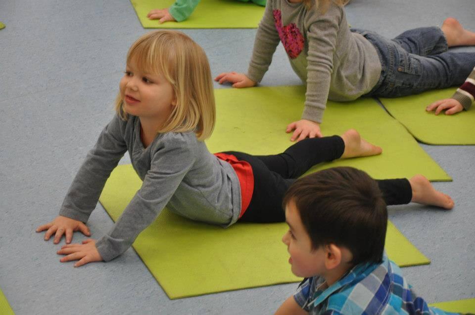 children performing yoga poses
