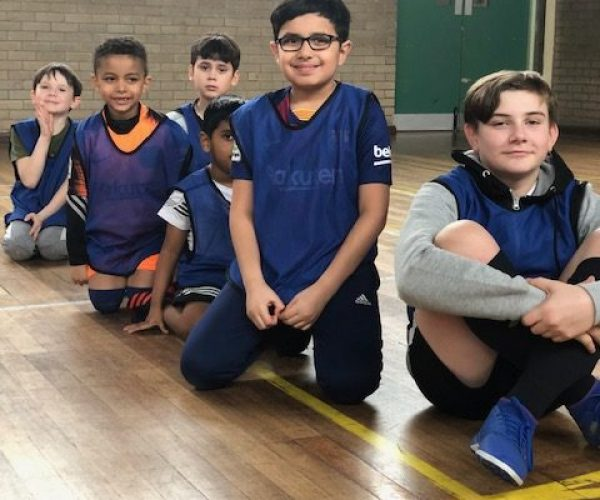boys sat in a sports hall